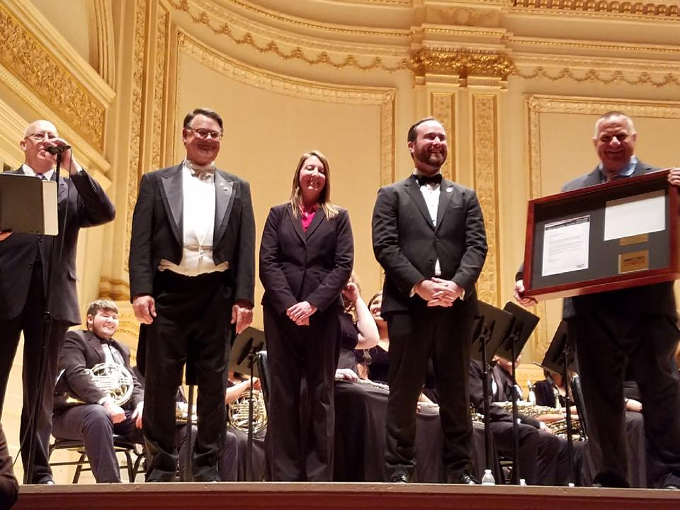 Stan Maulding and the Seguin High School Band is presented awards and certificates for performing at Carnegie Hall onstage