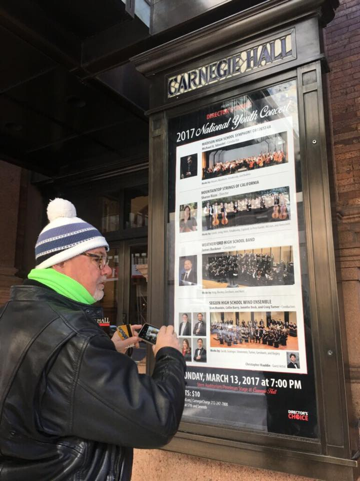 Stan Mauldin taking a photo of the 2017 National Youth Concert outside Carnegie Hall