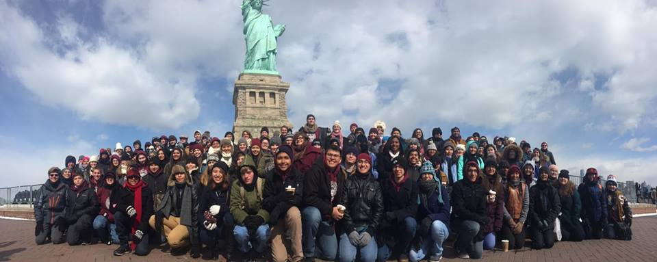 The entire Seguin High School Band posing together in front of the Statue of Liberty